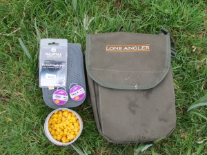 2 pints of maggots, sweetcorn, worms, spare hooks, shot and still room for more in the Lone Angler Bait Pouch.